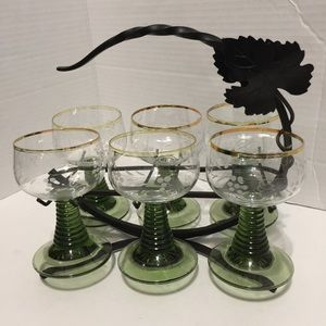 Six green cordial glasses with holder